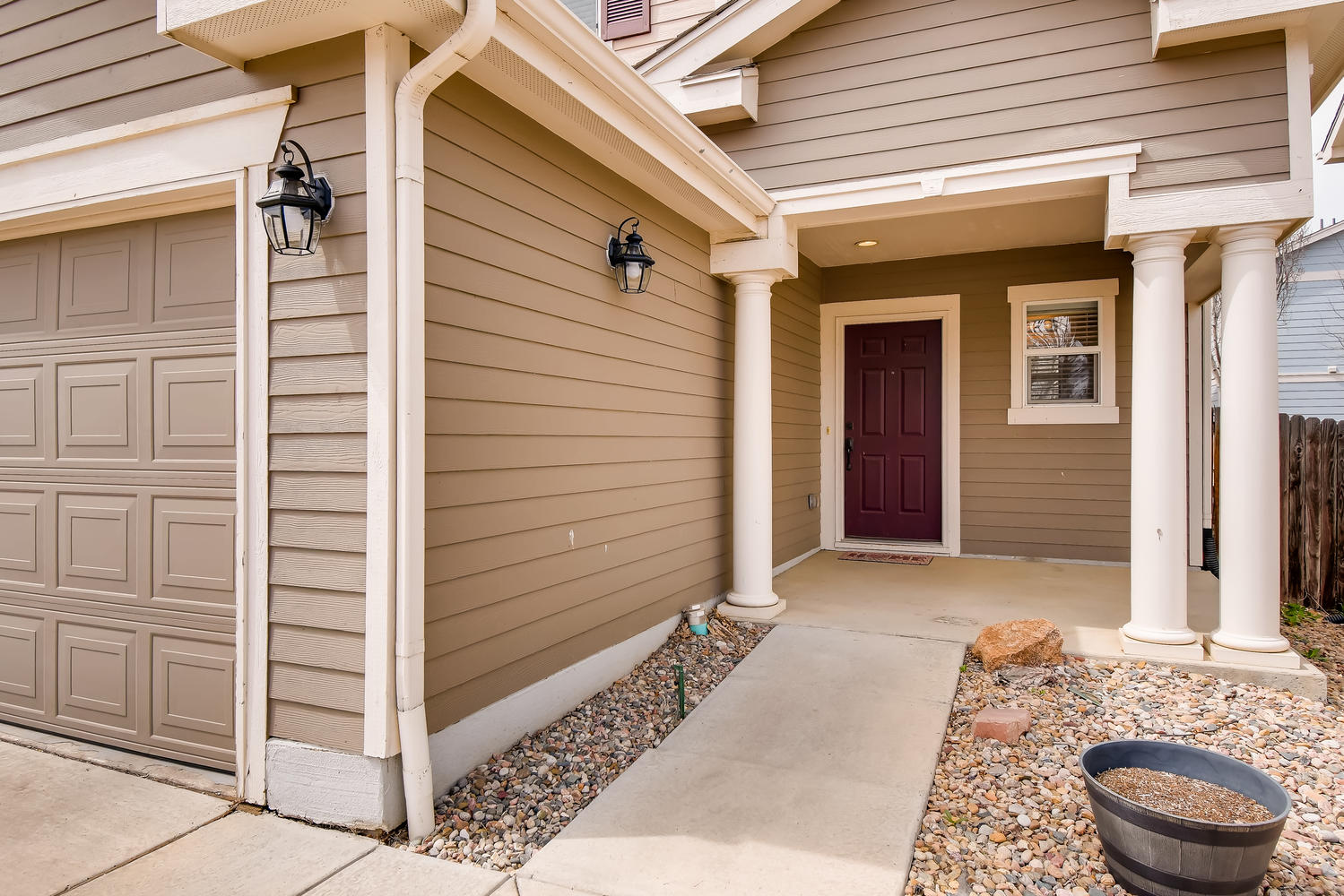 REAL ESTATE LISTING: 10595 Forester Pl Longmont CO Front Porch and Entry