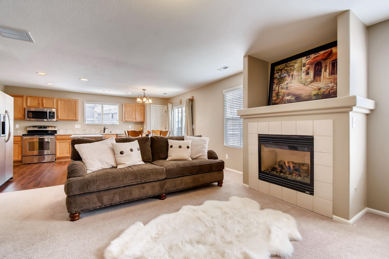 REAL ESTATE LISTING: 10595 Forester Pl Longmont CO Great Room and Kitchen