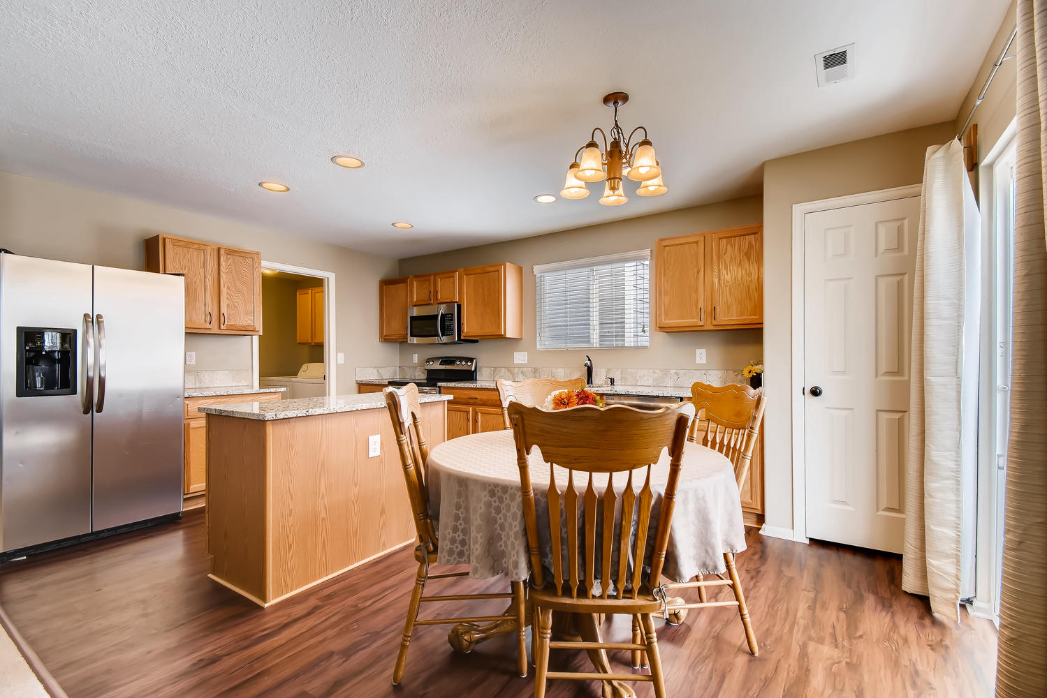 REAL ESTATE LISTING: 10595 Forester Pl Longmont CO Eating Area and Kitchen