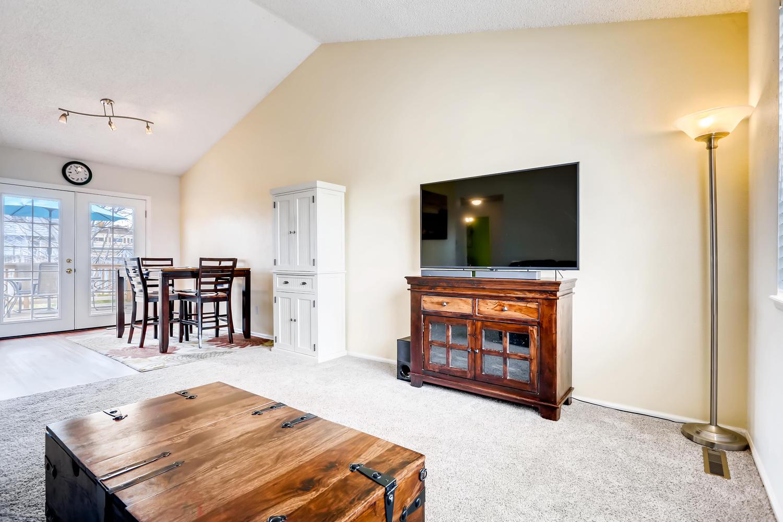 REAL ESTATE LISTING: 8725 S Yukon St Littleton CO Living Room & Kitchen