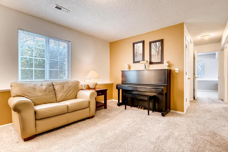 REAL ESTATE LISTING: 8725 S Yukon St Littleton CO Family Room
