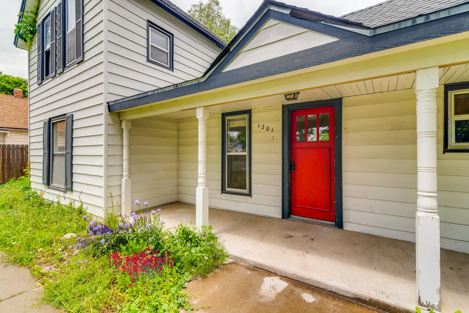 REAL ESTATE LISTING: 1201 E 1st Street Loveland CO Covered Front Porch