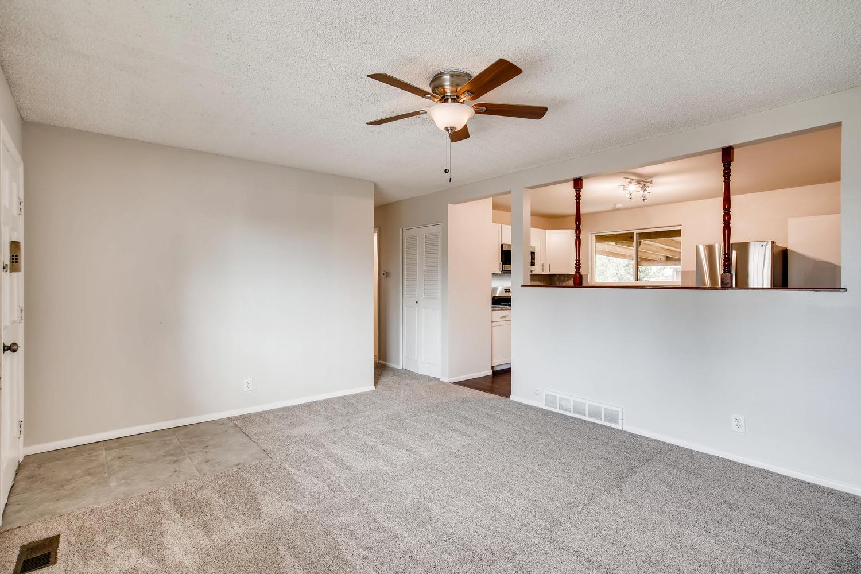 REAL ESTATE LISTING: 13040 Pensacola Place Denver Living Room