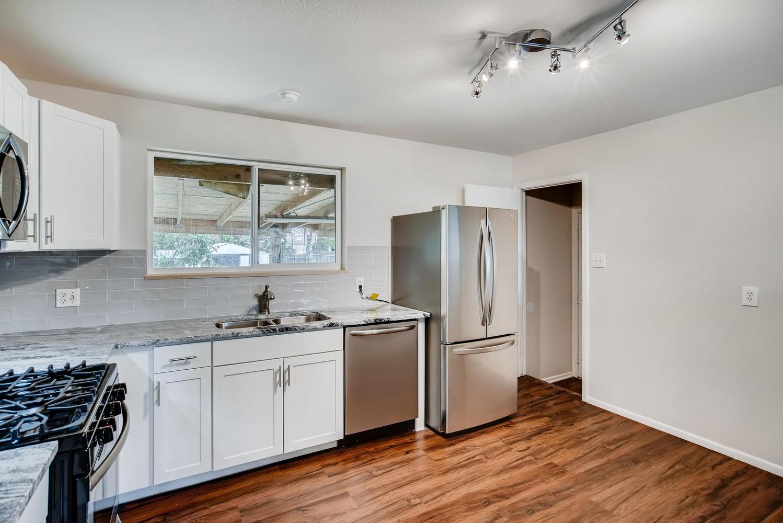 REAL ESTATE LISTING: 13040 Pensacola Place Denver NEW Kitchen