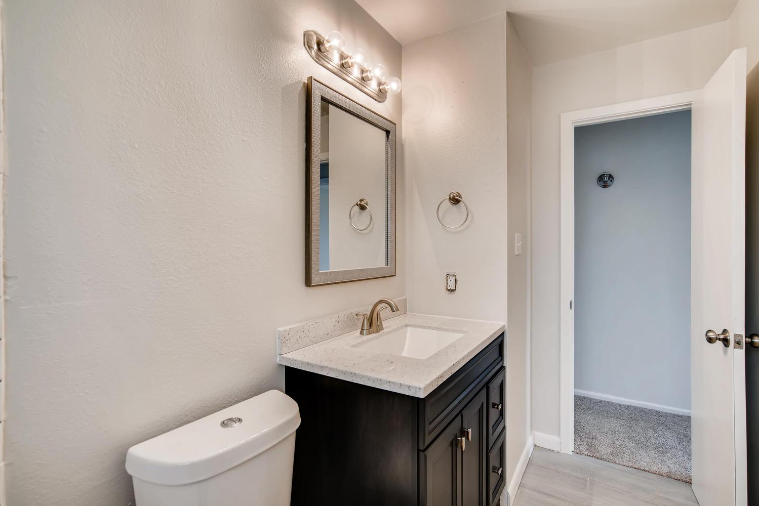 REAL ESTATE LISTING: 13040 Pensacola Place Denver NEW Main Level Bathroom