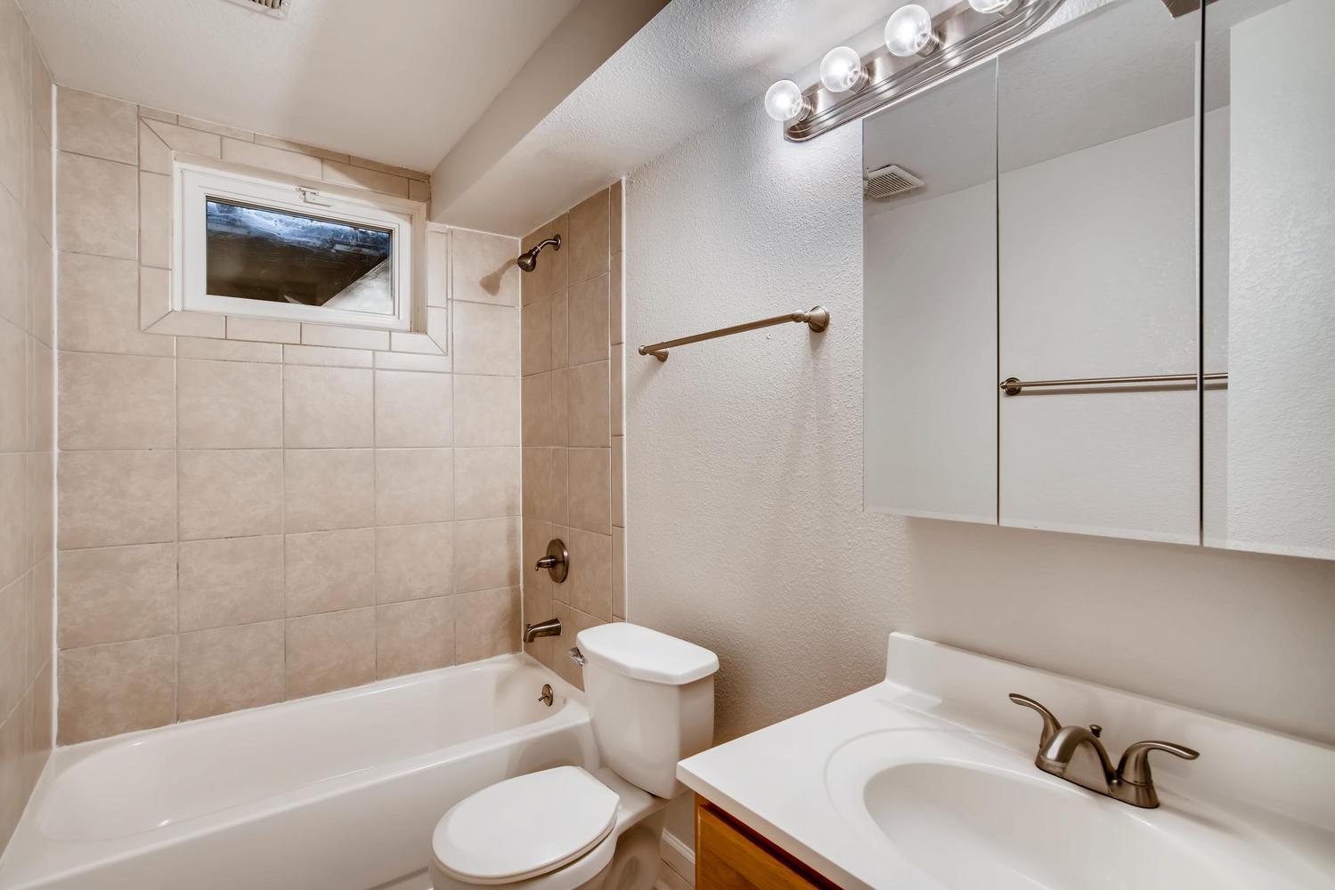 REAL ESTATE LISTING: 13040 Pensacola Place Denver Basement Bathroom