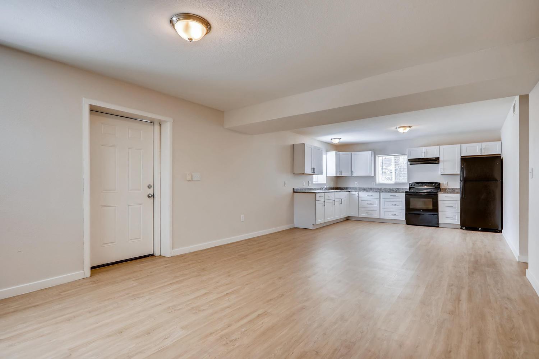 REAL ESTATE LISTING: 4337 Cook St Denver Unit B Living Room and Kitchen