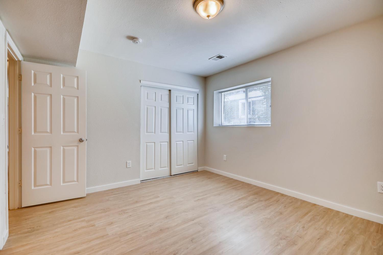 REAL ESTATE LISTING: 4337 Cook St Denver Unit B Master Bedroom