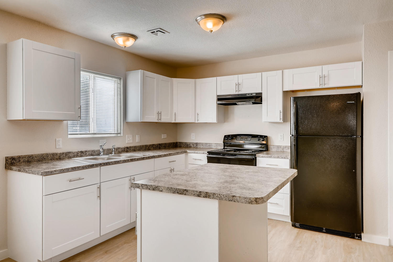REAL ESTATE LISTING: 4337 Cook St Denver Unit A Remodeled Kitchen
