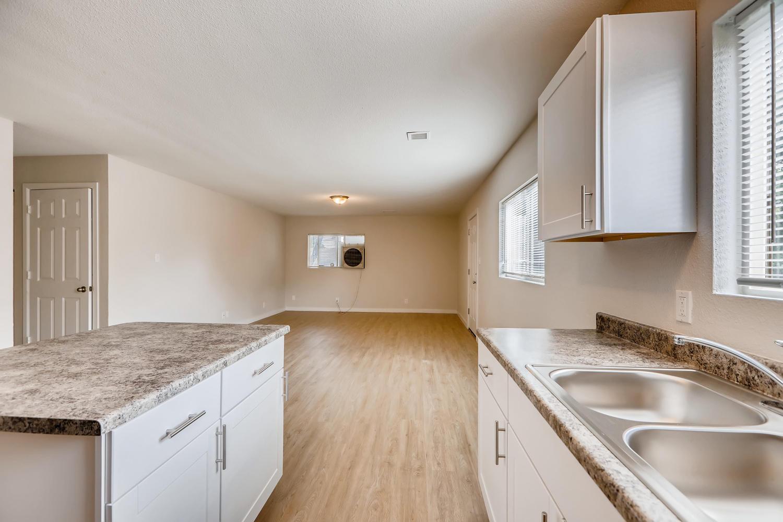 REAL ESTATE LISTING: 4337 Cook St Denver Unit A Kitchen & Living Room