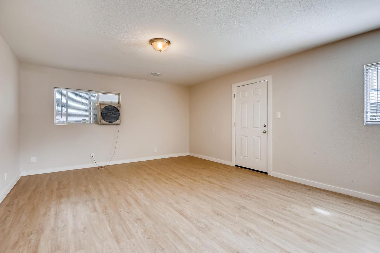 REAL ESTATE LISTING: 4337 Cook St Denver Unit A Living Room