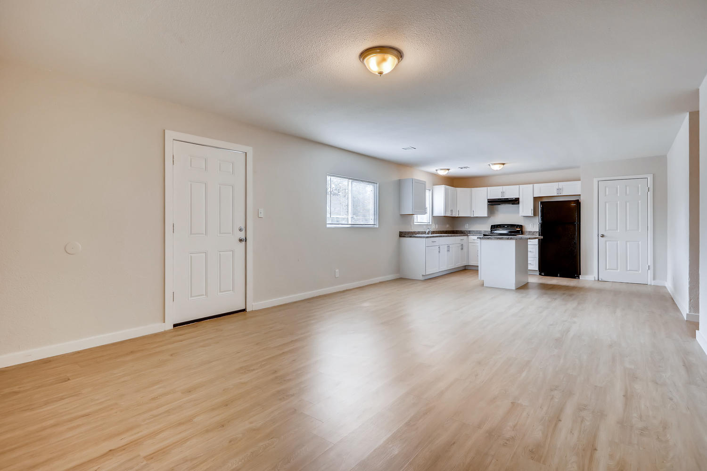 REAL ESTATE LISTING: 4337 Cook St Denver Unit A Living Room and Kitchen