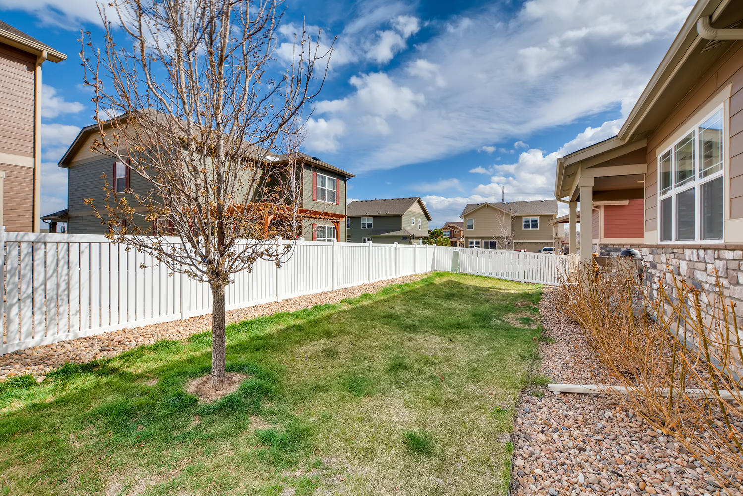 REAL ESTATE LISTING: 2182 Steppe Dr Longmont Covered Back Yard