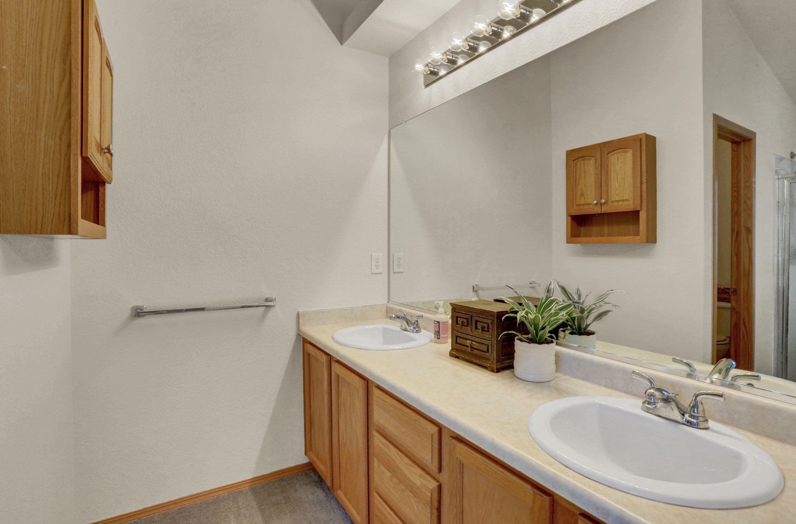 REAL ESTATE LISTING: 10502 Falcon St Firestone Master Bath Vanities