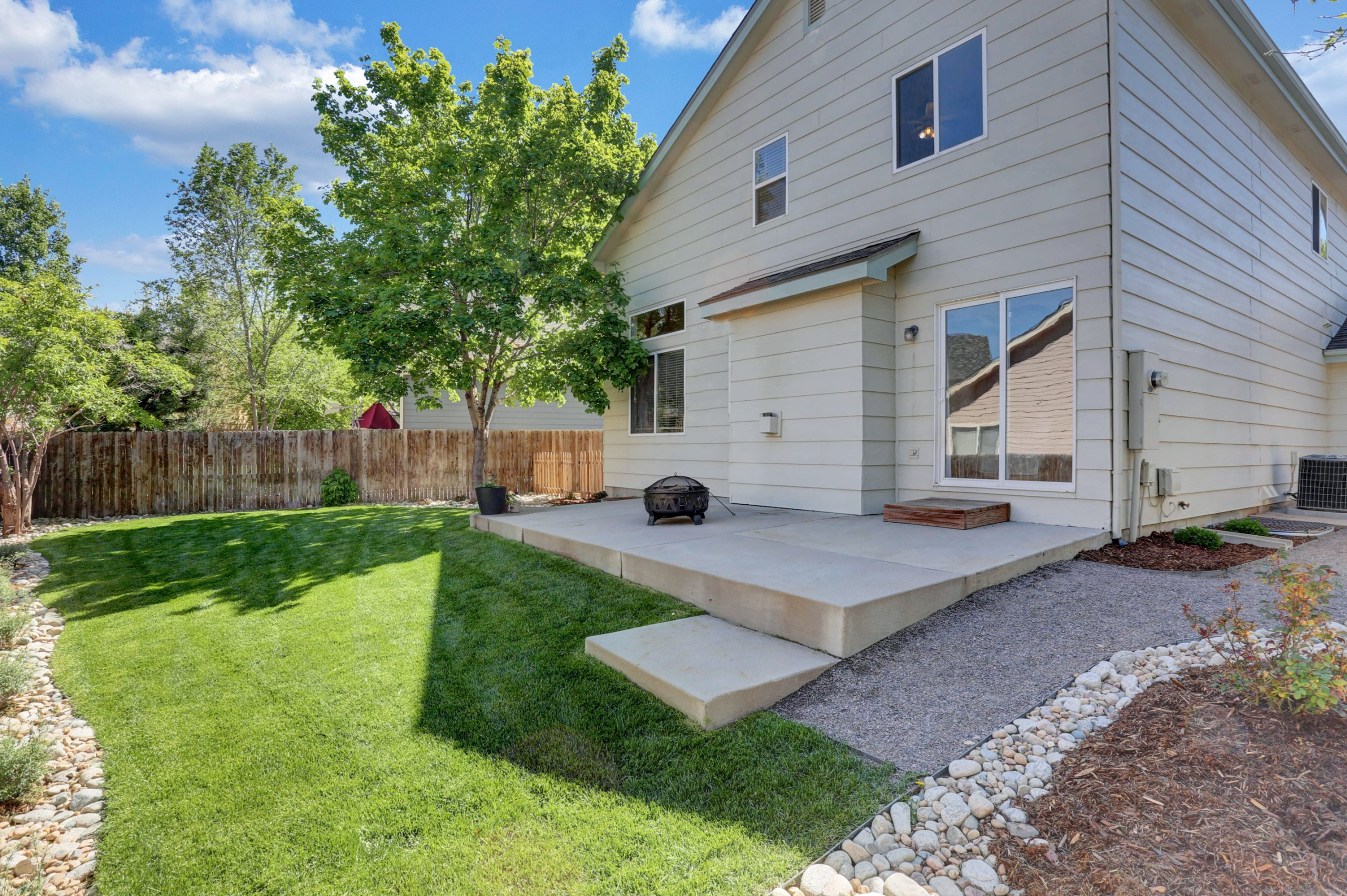REAL ESTATE LISTING: 10502 Falcon St Firestone Back Porch and Yard