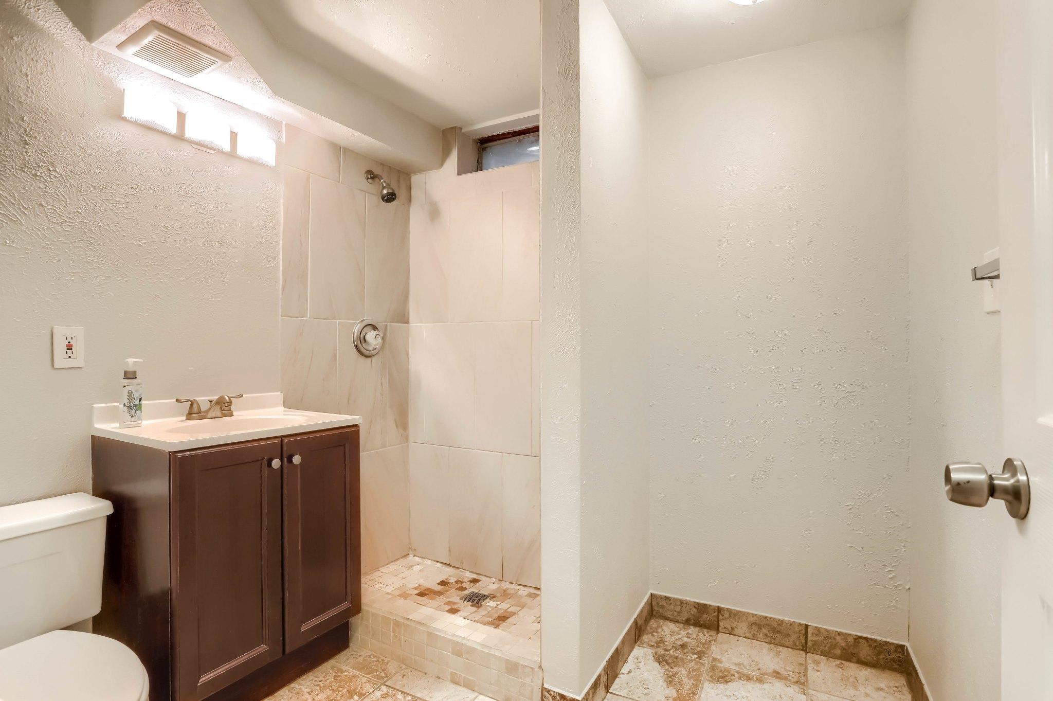 REAL ESTATE LISTING: 1309 Douglas Dr Denver Remodeled Basement Bath