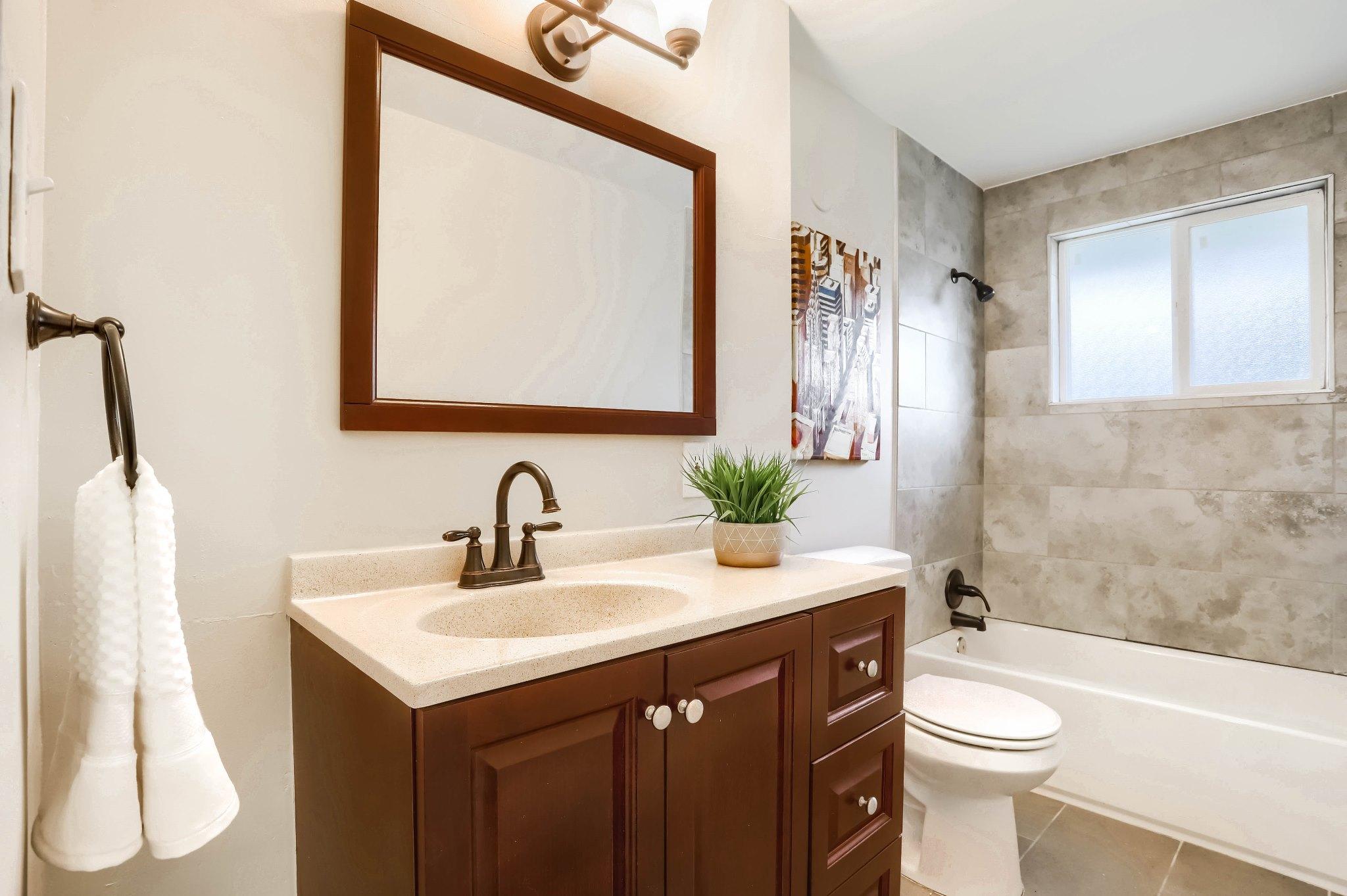 REAL ESTATE LISTING: 1309 Douglas Dr Denver Remodeled Bath